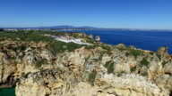 Aerial from Ponte Piedade and the lighthouse at Lagos Portugal video