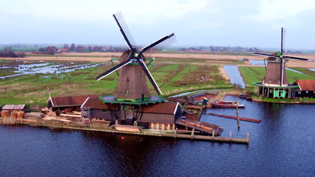 Aerial from traditional windmills at Zaanse Schans in the Netherlands video