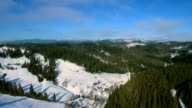 Aerial Helicopter View of of Cascade Mountain Range on Sunny Winter Day. Green tree in a winter day video