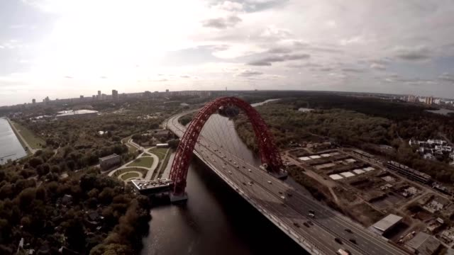 Aerial helicopter view of Zhivopisnyi Most (trsl.-Picturesque Bridge) over Moscow River. Moscow Russia. Zhivopisny Bridge is a cable-stayed bridge that spans Moskva River in north-western video