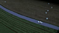 Aerial: high angle view of a white car driving on asphalt road between fields video