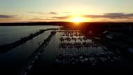 Aerial lake marina at sunset ascending video