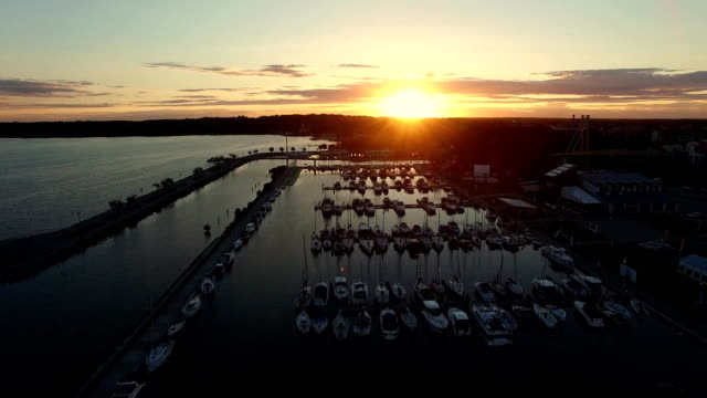 Aerial lake marina at sunset ascending video