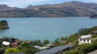Aerial landscape view of Lyttelton inner harbour New Zealand video