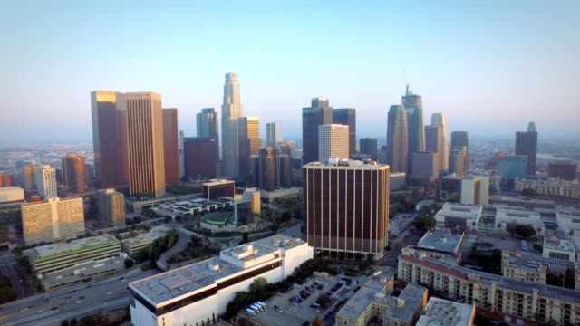 Aerial left to right pan of downtown Los Angeles California at sunset video
