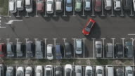 4K Aerial: Lift over Departing Car in Parking Lots video