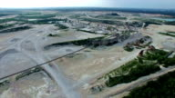 Aerial Limestone Extraction Open Pit Mine fly over the industrial factory Surface Mine video