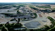 Aerial Limestone Extraction Open Pit Mine really high angle surface mine video