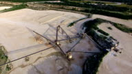 Aerial Limestone Extraction Open Pit Mine sunset Near Conveyor Belt Triangles video