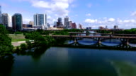 Aerial Lou Neff Point Flying over Town Lake rising over Bridges in front of Downtown Austin Texas video