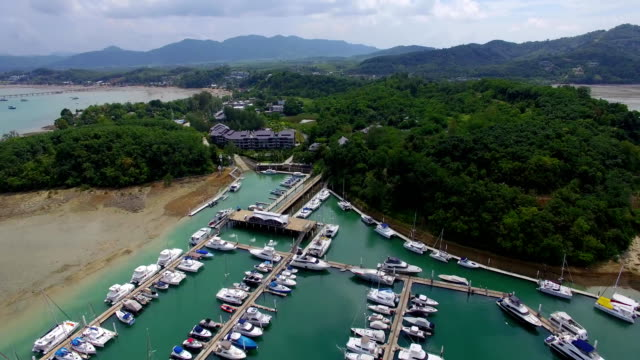 Aerial: Luxury boats and yahts standing in grand marina. Phuket. Thailand. video