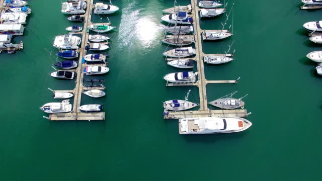 Aerial: Luxury boats and yahts standing near shore in marina. Phuket. Thailand. video