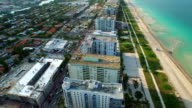Aerial Miami Beach flying over oceanfront condominiums video