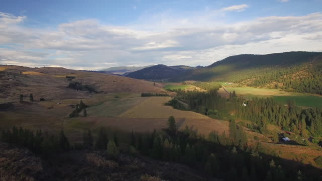 Aerial Nature Shot of Valley with Farms at Golden Hour video