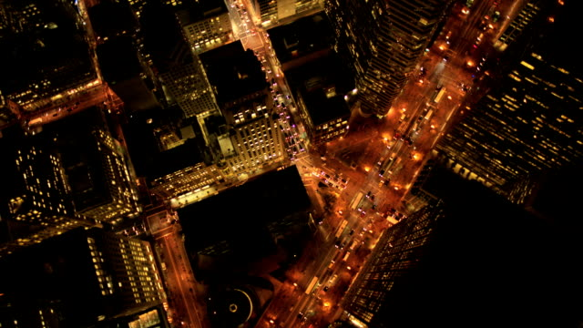 Aerial night vertical view of lights on skyscrapers, USA video