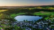 Aerial of crater lake Schalkenmehrener Maar in Germany video