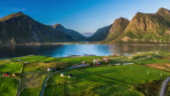 Aerial of fjord with traditional Norwegian village, Lofoten Islands Norway video