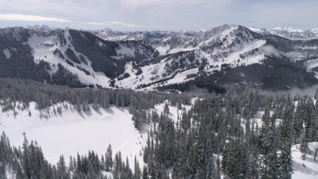Aerial of Pacific Northwest Winter Ski Resort Stevens Pass from Skyline Lake video