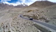 Aerial of road in Himalayas near Tanglang la Pass - Himalayan mountain pass on the Leh-Manali highway. Ladakh, India. video