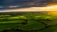 Aerial of rural landscape with farmland in Ireland video