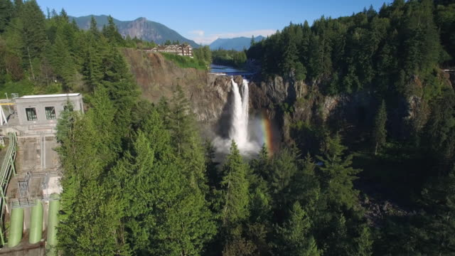 Aerial of Snoqualmie Falls Hydroelectric Facility with Rainbow in Waterfall video