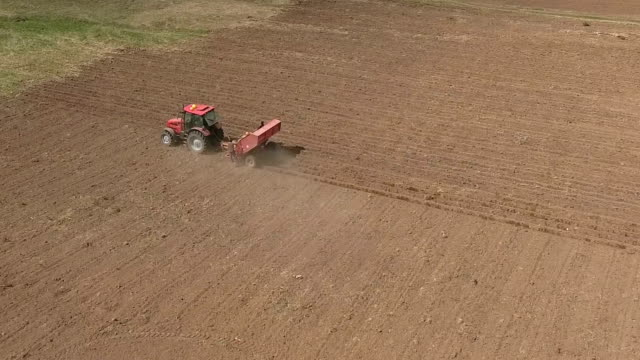 Aerial of tractor on harvest field video