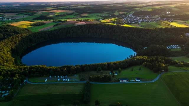 Aerial of volcanic Maar Pulvermaar in Germany video