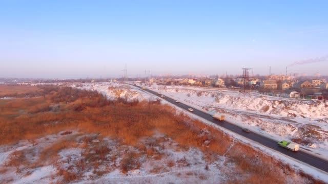 Aerial of winter road near Kuyalnik Estuary in Odessa, Ukraine video