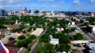 Aerial Over East Austin Close fly by Texas Flag towards downtown Texas capital city video
