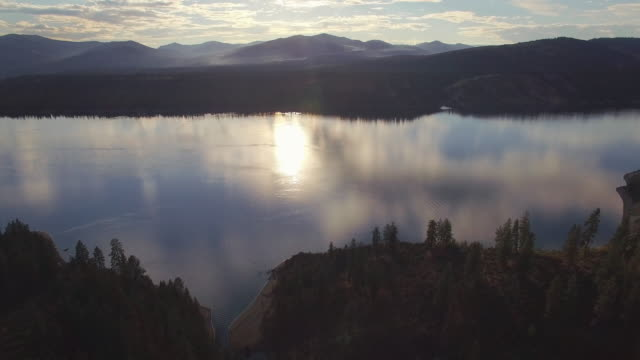 Aerial Pan of Lake Roosevelt at Sunset with Cloud Reflection on the Water video
