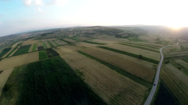 Aerial panorama over green fields farms summer video