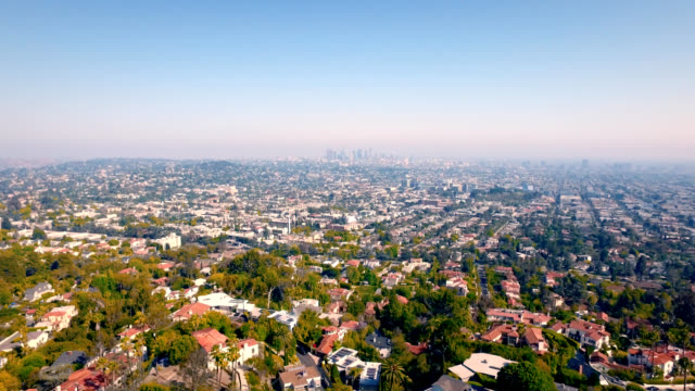 Aerial pull downtown Los Angeles skyline and the massive size of Los Angeles. video