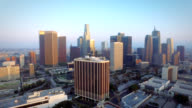 Aerial push into downtown Los Angeles California at sunset video
