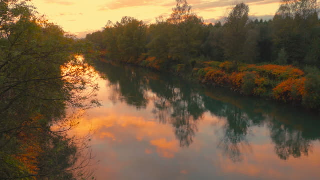4K Aerial: Reveal Autumn River at Dusk video