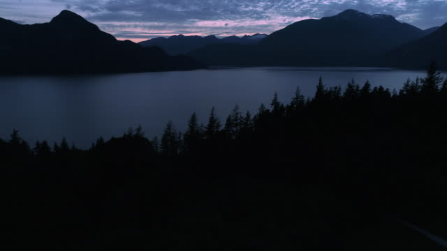 Aerial Reveal of Mountain Islands and Ocean Water at Dusk in British Columbia video