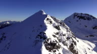 aerial rocky snow covered mountains video