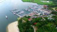 Aerial sailboat harbour marina on river and sea video