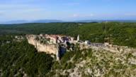 Aerial: Seaside village on the edge of a cliff. Destination scenic, Lubenice video