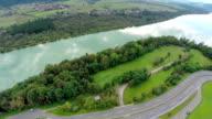 Aerial shoot of a lake and motorway bridge video
