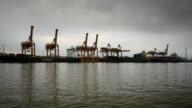 Aerial shoot of Containers at Bangkok commercial port along Jao Phra Ya River, Bangkok, Thailand. video