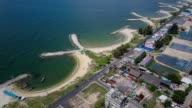 Aerial shoot. Stone wave breaker into the sea at Map ta phut Industrail Estate, Rayong, Thailand video