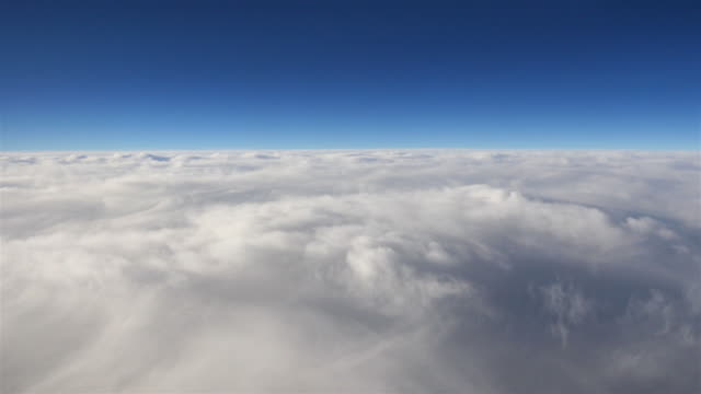 Aerial shot above the clouds in 4K video