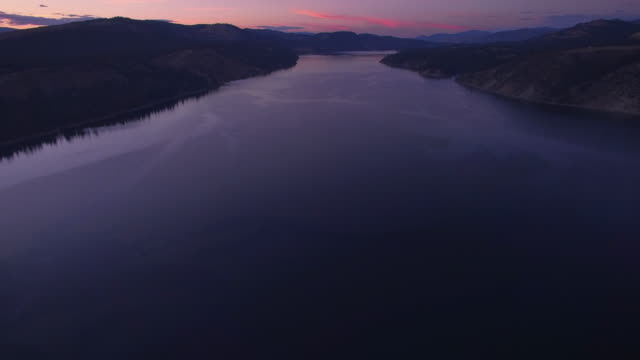 Aerial Shot After Sunset Over Lake Roosevelt with a Vibrant Purple video