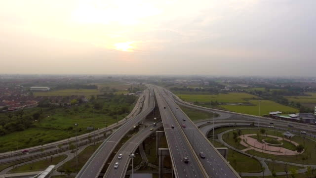 Aerial shot : Beautiful sunset and highway with traffic at dusk video