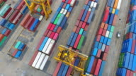 Aerial shot Container Cargo freight ship with working crane bridge in shipyard video