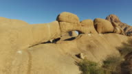 4K aerial shot flying through the granite arch of the Spitzkoppe mountains video