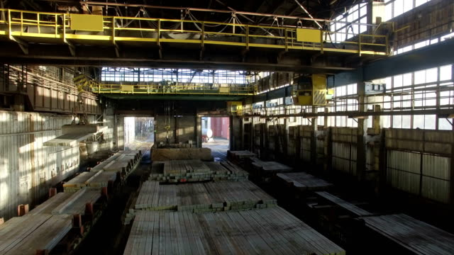 Aerial Shot Inside Big Industrial Building With Moving Electromagnetic Cranes. video