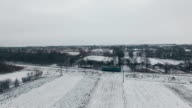 Aerial shot lonely train on railway in winter video
