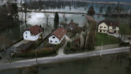 Aerial shot of a few houses surrounded by flood video