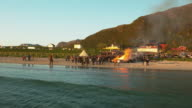 Aerial shot of a fire at beachparty video